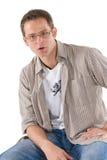 Homme s'asseyant en passant sur des selles Image stock