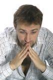 Homme s'asseyant pensant Photographie stock libre de droits
