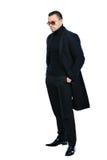 Homme sexy de portrait intégral dans le manteau noir d'isolement Image stock