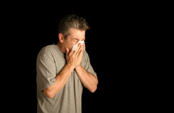 Homme soufflant son nez Photo stock