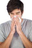 Homme soufflant son nez Image libre de droits
