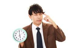 Homme souffrant avec l'horloge Photo libre de droits