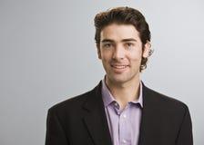 Homme souriant à l'appareil-photo Photographie stock