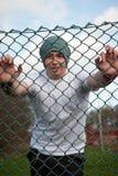 Homme souriant derrière la frontière de sécurité 2 Photos libres de droits