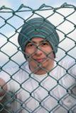 Homme souriant derrière la frontière de sécurité 3 Photos stock