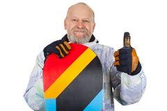 Homme supérieur actif avec le surf des neiges Photos libres de droits