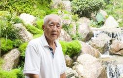 Homme supérieur asiatique de sourire Photo libre de droits