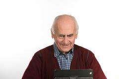 Homme supérieur avec la tablette Photo libre de droits