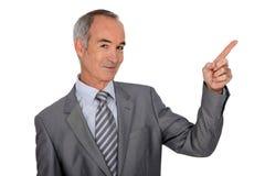 Homme supérieur avec le doigt  Images stock