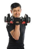 Homme supérieur courbant Dumbell Photographie stock