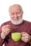 Homme supérieur de Cheerfull avec la tasse verte, d'isolement sur le blanc Photos libres de droits