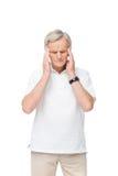 Homme supérieur fatigué avec le mal de tête Image libre de droits