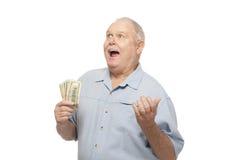 Homme supérieur heureux avec des billets d'un dollar photographie stock