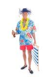 Homme supérieur marchant à la plage Image libre de droits