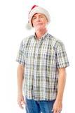 Homme supérieur portant le chapeau et le sourire de Santa Photos stock