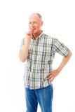 Homme supérieur se tenant avec le doigt dans la bouche Photo libre de droits