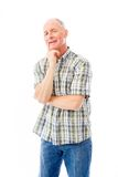Homme supérieur souriant avec la main sur le menton Image stock