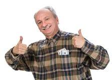 Homme supérieur tenant des billets d'un dollar photographie stock