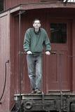 Homme sur la cambuse de train photos libres de droits