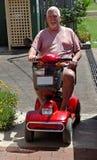Homme sur la poussette électrique #2 image libre de droits