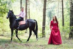 Homme sur le cheval et la fille Photos libres de droits