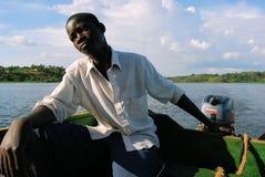 Homme sur le lac Victoria Photographie stock libre de droits