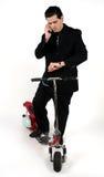 Homme sur le scooter Photographie stock libre de droits