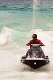 Homme sur le scooter de mer Photos stock