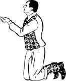 Homme sur ses genoux à prier Photos libres de droits