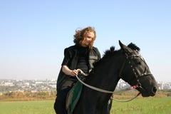 Homme sur un cheval Image libre de droits