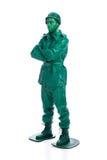 Homme sur un costume vert de soldat de jouet Photographie stock libre de droits