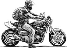 Homme sur une moto Photos libres de droits