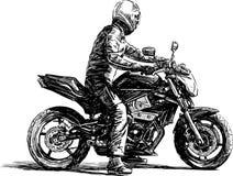 Homme sur une moto Photo stock