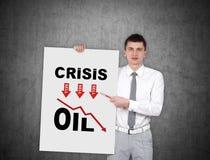 Homme tenant l'affiche avec le diagramme de srisis Photo stock