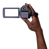 Homme tenant la caméra vidéo Photos stock