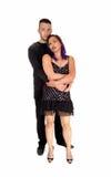 Homme tenant la fille dans le bras Image stock