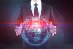 Homme tenant la sphère Images libres de droits