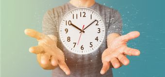 Homme tenant un rendu de la minuterie 3d d'horloge Images stock