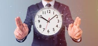 Homme tenant un rendu de la minuterie 3d d'horloge Photographie stock