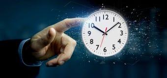 Homme tenant un rendu de la minuterie 3d d'horloge Images libres de droits