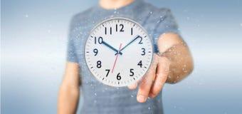 Homme tenant un rendu de la minuterie 3d d'horloge Image libre de droits
