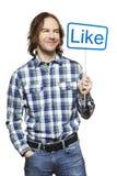 Homme tenant un sourire social de signe de media Images libres de droits