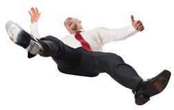 Homme tombant vers le bas Image libre de droits