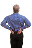 Homme touchant le sien en arrière Photos libres de droits