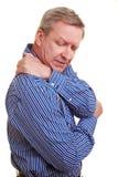 Homme touchant son épaule douloureuse Image stock