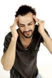 Homme triste souffrant le mauvais mal de tête Image stock