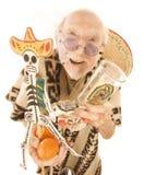 Homme vendant des éléments de touriste de kitsch Photo stock