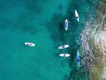 Hommelmening van SUP surfers royalty-vrije stock afbeelding