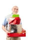 Hommes adultes avec des cadeaux de Noël au-dessus de blanc images stock