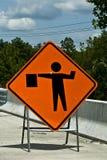 Hommes au signe de travail Image libre de droits